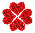 Pomegranate seeds in heart shape isolated on white background Royalty Free Stock Image