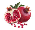 Pomegranate whole and half cut leaves isolated on white Royalty Free Stock Photo