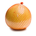 Pomelo fruit wrapped in plastic reticle Royalty Free Stock Photos