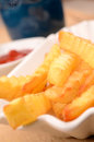 Pommes frites close up of in awhite bowl selective focus on foreground Stock Photography