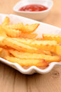 Pommes frites in a white bowl Stock Photo