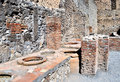 Pompei ruins toilets from the volcano eruption naples italy Royalty Free Stock Images