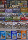 Pompei tour guides italy in different languages in a shop near the site Royalty Free Stock Photo