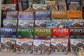 Pompei tour guides italy in different languages in a shop near the site Stock Photos
