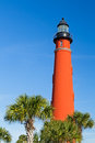 Ponce inlet light and palms flanked here by the brilliant red lighthouse at florida s de leon formerly mosquito has stood watch Stock Images
