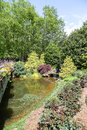Pond by Bridge in Landscaped Garden Royalty Free Stock Photo