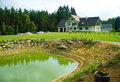 Pond and country house Royalty Free Stock Images