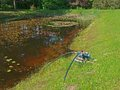 Pond with pump electric water on coast of Stock Photo