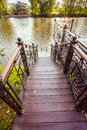 Pond with wooden pier Royalty Free Stock Photo