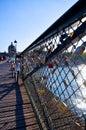 Pont des arts in paris locks on the bridge sunshine on the river Royalty Free Stock Photo