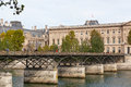 Pont des arts through seine bridge of passerelle the first iron bridge of paris the river is built in Royalty Free Stock Photography