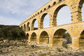 Pont du gard ancient roman aqueduct bridge crosses gardon river vers pont du gard near remoulins southern france part nimes Royalty Free Stock Photos