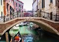 stock image of  Venice, Italy - a picturesque view of Ponte del Angelo bridge, a turquoise canal and colorful old houses
