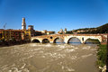 Ponte pietra in verona italy italian for stone bridge once known as the pons marmoreus is a roman arch bridge crossing the adige Stock Images