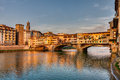 Ponte vecchio florence italy landscape at sunset of view of the famous landmark old bridge a medieval bridge over the arno river Royalty Free Stock Image