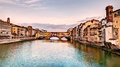 Ponte vecchio florence italy landscape at sunset of view of the famous landmark old bridge a medieval bridge over the arno river Stock Images