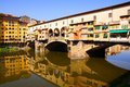 Ponte vecchio historic with reflections florence italy Stock Photos