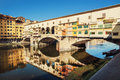 Ponte Vecchio is mirroring in the river Arno, Florence Royalty Free Stock Photo
