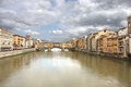 Ponte vecchio and waters of arno at dawn florence italy Royalty Free Stock Images