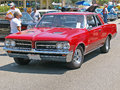 Pontiac gto this is a dark red which started the muscle car trend it has after market chrome wheels Royalty Free Stock Images