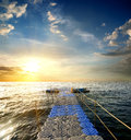 Pontoon in the sea with handrails at sunset Stock Image