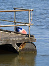 Pontoon with steel railings and bouy Royalty Free Stock Photo