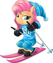 Pony beautiful who is engaged in a driving on skis Royalty Free Stock Photo