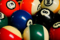 Pool balls on a billiard table.