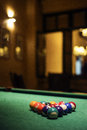 Pool balls on billiards table in cozy bar