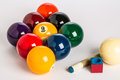 Pool balls racked for nine ball with cue stick and chalk in foreground Stock Photography