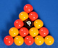 Pool balls yellow orange and black Royalty Free Stock Photography