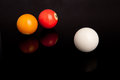 Pool or billiard balls on black reflective background Stock Photography
