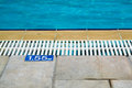 Pool depth sign indicating water situated on one side of swimming Royalty Free Stock Images