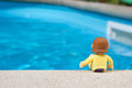 Pool doll relaxing by the Stock Photo