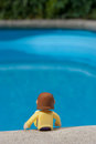 Pool doll relaxing by the Stock Photos