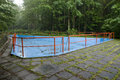 Pool drained blue with red railings swimming in the middle of the forest Stock Images