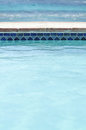 Pool outdoor background blue water blue tiles Royalty Free Stock Photos