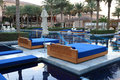 Pool with sunloungers in a lusury resort hotel dubai united arab emirates Royalty Free Stock Image