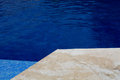 Pool swimming blue water detail in summer time Royalty Free Stock Photos