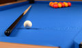 Pool table and balls cue on a blue baize Royalty Free Stock Image