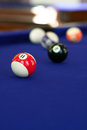 Pool table billiard balls on a purple fabric shallow depth of field with sharpest focus on the ball Royalty Free Stock Images