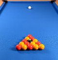 Pool table closeup of balls arranged on a blue baize Royalty Free Stock Image