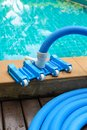 Pool vacuum cleaning flexible hose on the Royalty Free Stock Images