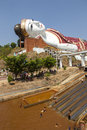 Pool water slides sits giant reclining buddha image win sein taw ya monastery near mawlamyine southern myanmar Royalty Free Stock Photos