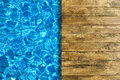 Pool water surface and wooden deck Royalty Free Stock Photo