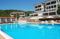 Pool and white buildings in Greek hotel. Royalty Free Stock Photo
