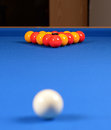 Pools balls on a blue table pool set up baize with the white ball in the foreground Stock Photography