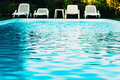 Poolside chairs Royalty Free Stock Photo