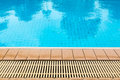 Poolside and drainage ditches blue pool water Royalty Free Stock Image
