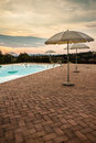 Poolside dusk some luxurious parasols on the at Stock Image